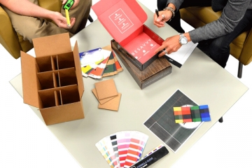 Consult with customers about printing and packaging design